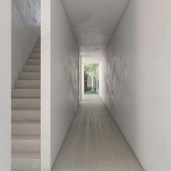 Polished Plaster White Hallway with stairway on the leftand outside view at end of hallway