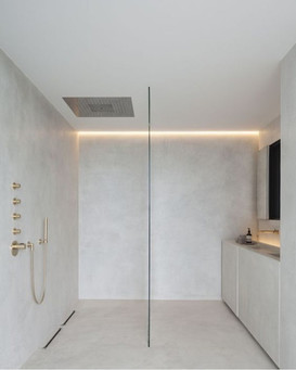 White Micro-cement bathroom with gold fittings