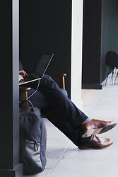 man-sits-with-laptop.jpg