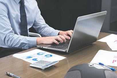 office-staff-typing-on-laptop.jpg