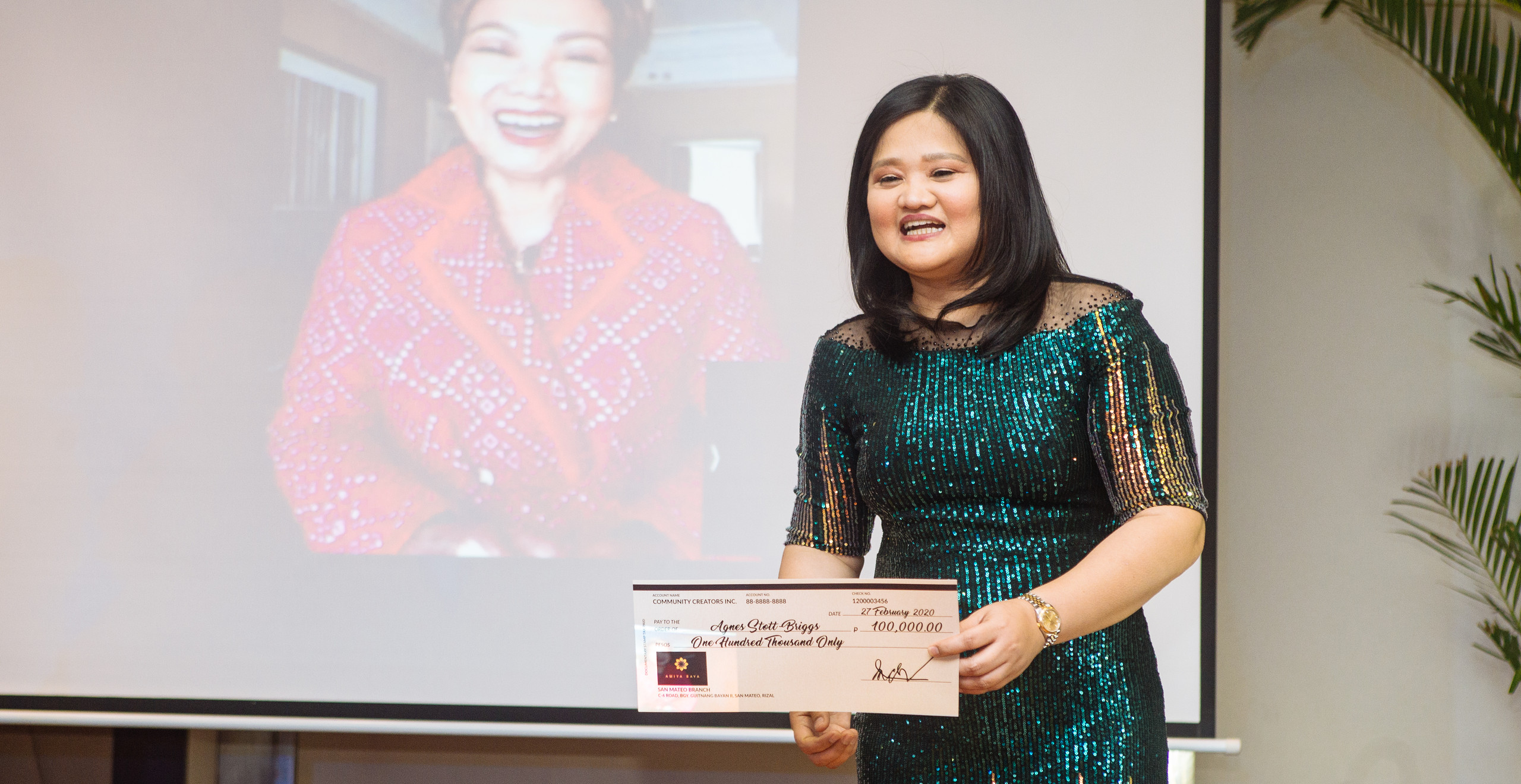 CCI President Ms. Ma. Charina Garcia gives virtual award to Annual Top Property Consultant Ms. Agnes Stott-Briggs who was out of the country at the time.