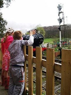 Children Waving at Steam Train.JPG