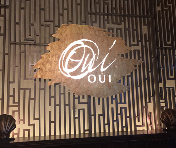 Oui Restaurant Sign