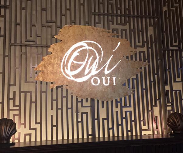 Oui Restaurant Sign
