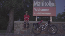Marlene at the Manitoba Saskatchewan border