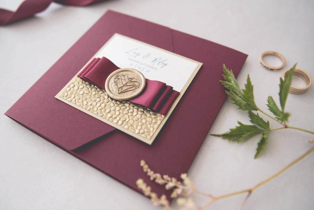 luxury handmade pocketfold wedding invite burgundy and gold wax seal