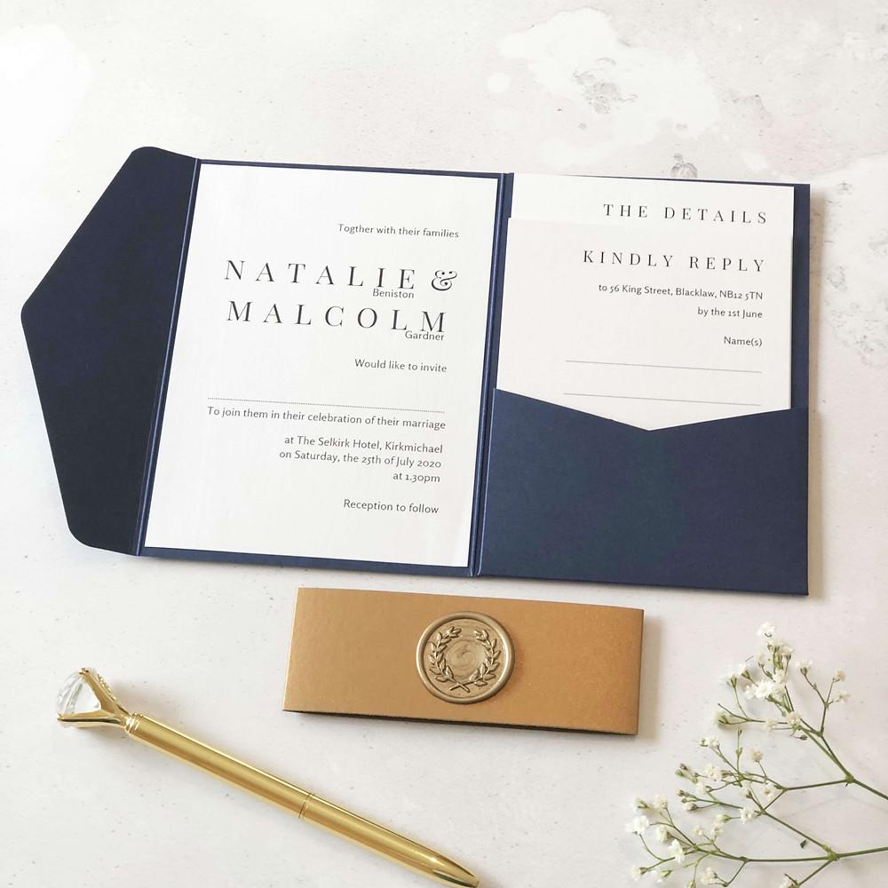 modern handmade wedding invitation in navy and gold wax seal