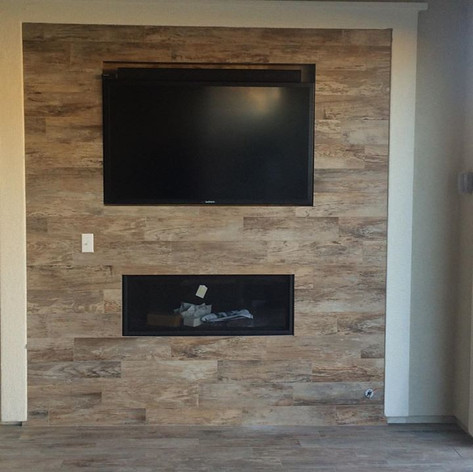 Outdoor fireplace with 55 inch Sunbrite.