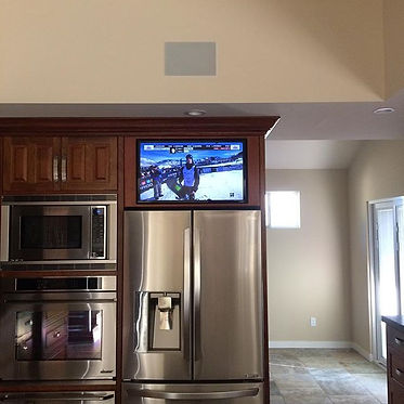 32 in. Samsung above refrigerator built into cabinets.