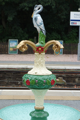 Metal sculpture of Heron on the southbound platform at Pitlochry Station