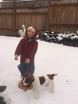 Ole in the snow, with his dog