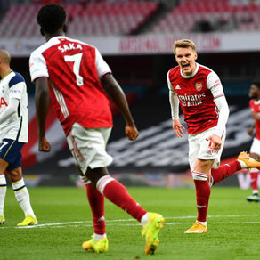 Impressive Gunners hang on for derby delight
