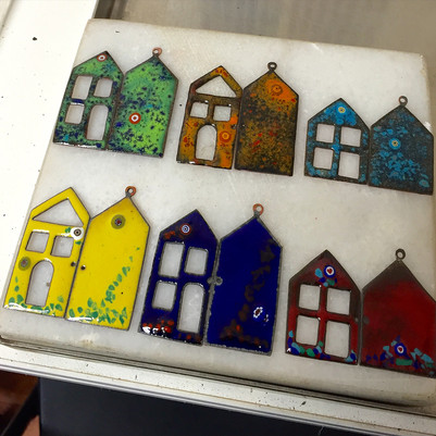 designing process of a book necklace: colorful enameled houses with millefiori beads.