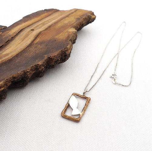 'in the rectangular frame, under the sea' mixed metal oxidized handmade necklace