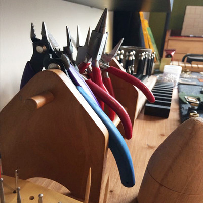 from the bench; pliers, metalworking tools.
