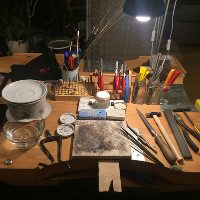tools and materials of jewelers on the bench.
