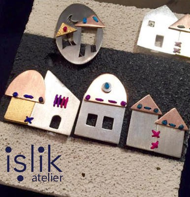 a collection for an exhibition: İşlik Atelier hometown, stitched houses.