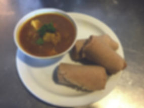 Chikcken Curry and injera.jpg