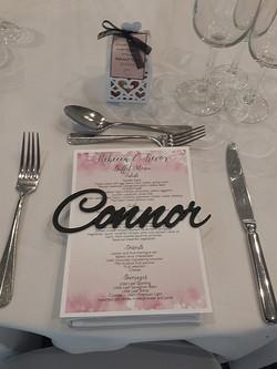 Laser cut guest names and menu