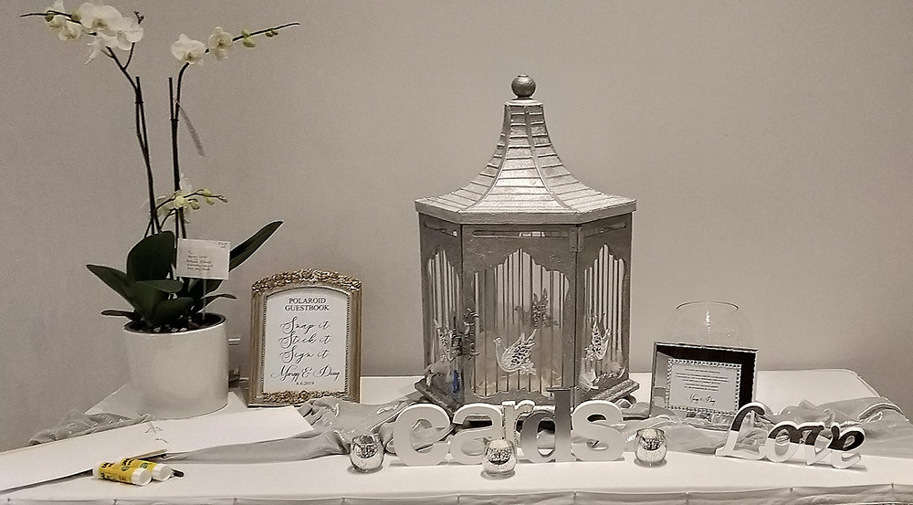 Hand crafted bespoke silver birdcage wishing well styled with selected accessories for Margy and Doug's wedding
