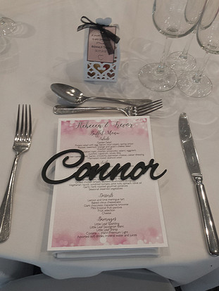 Laser cut guest names and menu