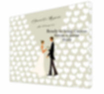 Bridal couple with love hearts on a wedding guest signing canvas.