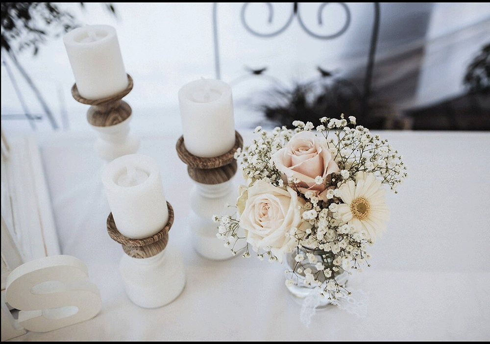 Three Sisters white candle holders looking divine with pretty roses