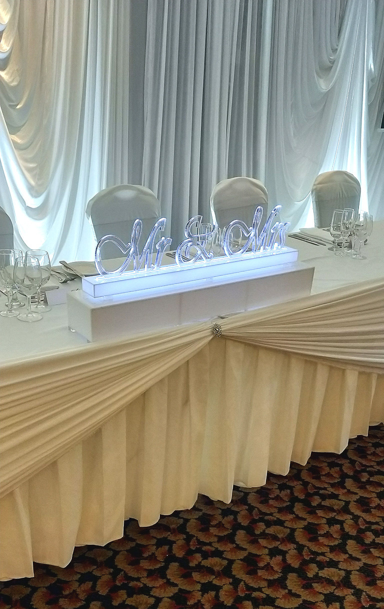 Custom made LED and acrylic Mr and Mrs sign for the Bridal table centrepiece table
