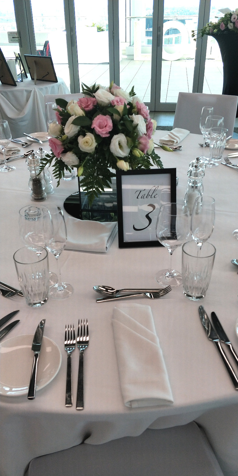 Pretty fresh florals with Bride's own table numbers