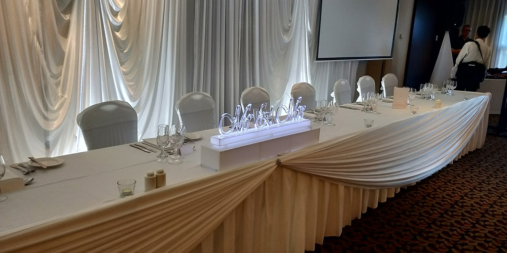 Custom made LED and clear acrylic Mr and Mrs sign  as the Bridal table centrepiece for Connie and Brendan