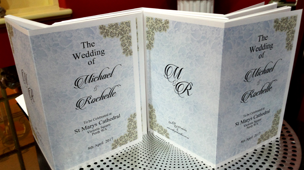 Church Book covers with a printed lace background