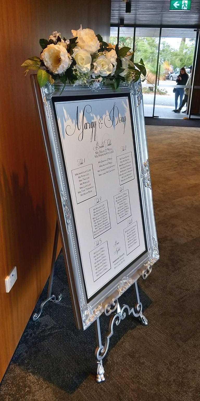 Custom Seating design and print on the silver Venetian Frame and Silver wrought iron easel for Margy and Doug's wedding