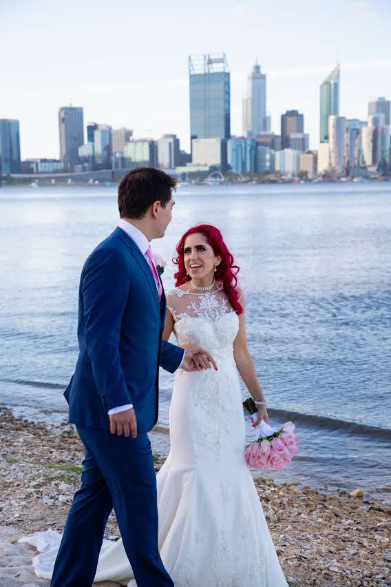 Newly married Connie and Brendan taking a stroll on the South Perth Foreshore with Perth City in the background