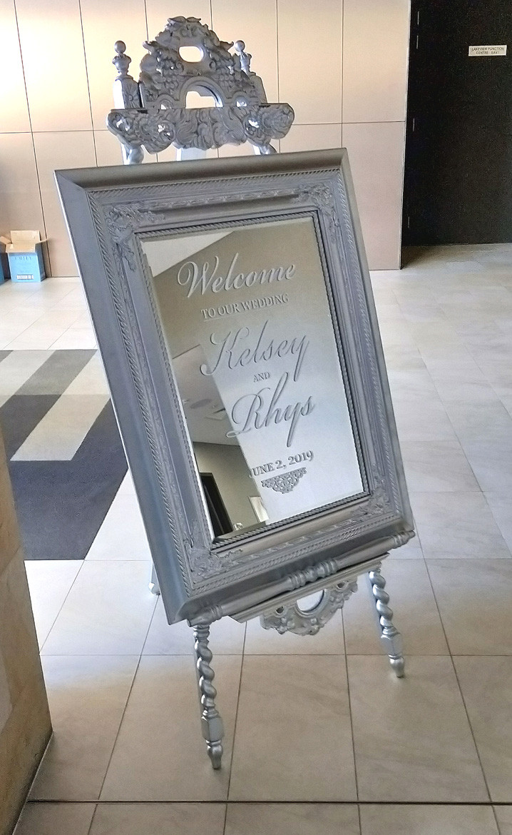Welcome sign for Rhys and Kelsey on the Silver Renaissance mirror with white writing and our exclusive silver Gothic Easel