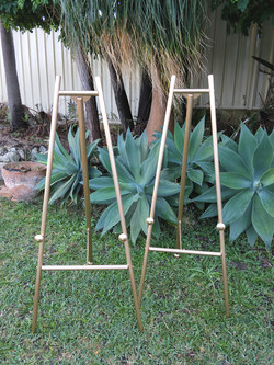 Matching pair of gold easels