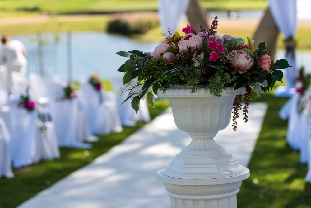 Our classic Urns on Pedestals with silk flowers