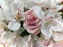 Closeup of Cymbidium orchids and roses