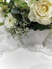 Cloesup of  florals in White sq ceramic