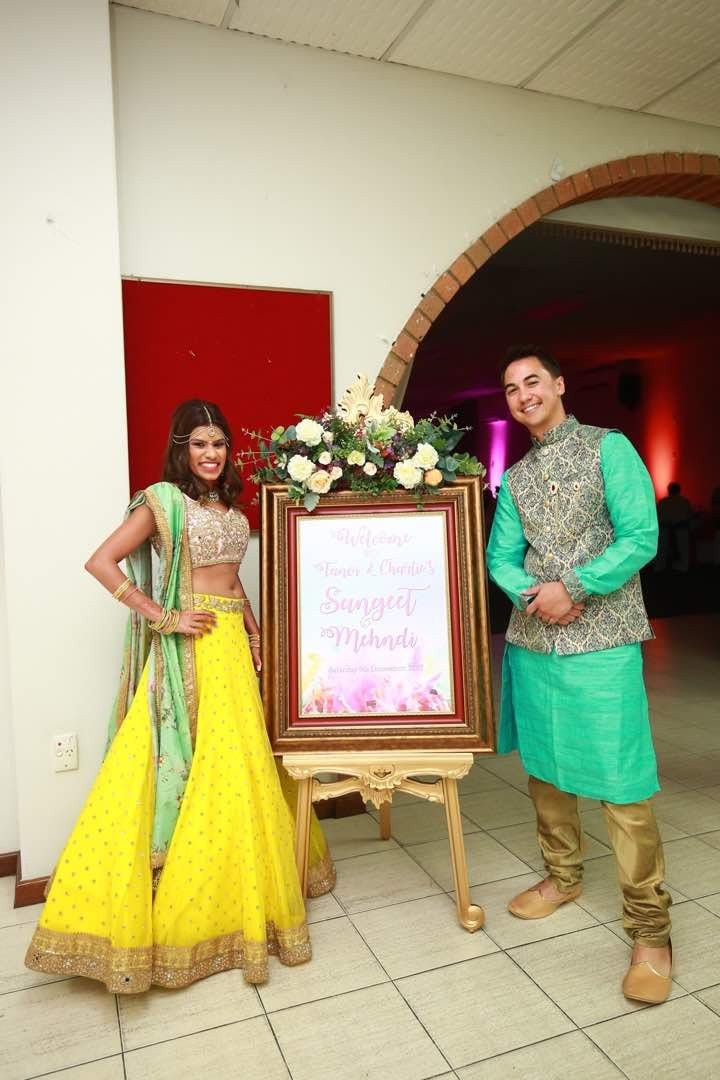 Tanvi & Charlie with the colourful Welcome Sign