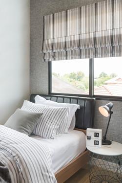 Teen bedroom stripped roman shade