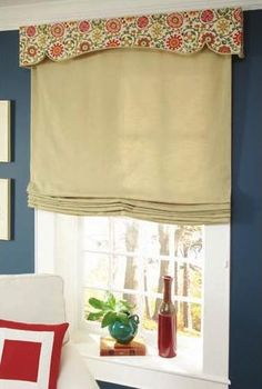 mini cornice with roman shades