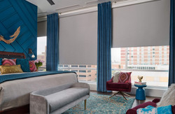 Large window of roller shades and a pop