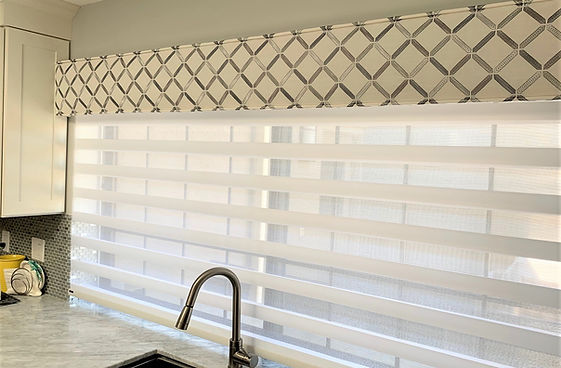 gray and white valance and shades over s