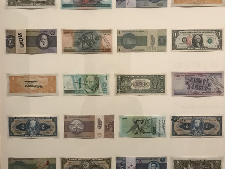 Banknotes stacked on the vinyl player