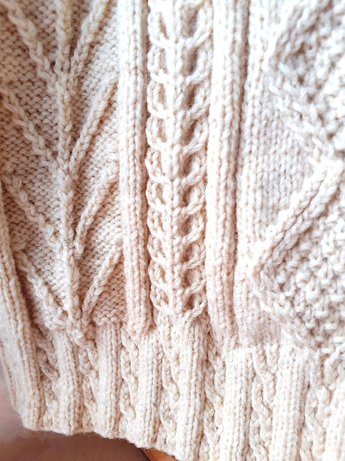 Pattern of an Aran sweater. Handknit with Irish natural wool
