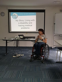 Woman sitting in a wheelchair presenting and talking