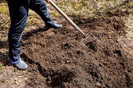 farmer-working-garden-spring-organic-fer