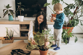 mother-with-little-son-cultivating-plant