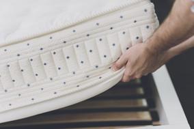 close-up-man-lifted-mattress-look-bed-fr