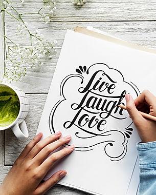 An artist creating hand lettering artwor